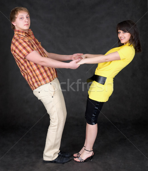Couple is turned keeping for hands Stock photo © pzaxe
