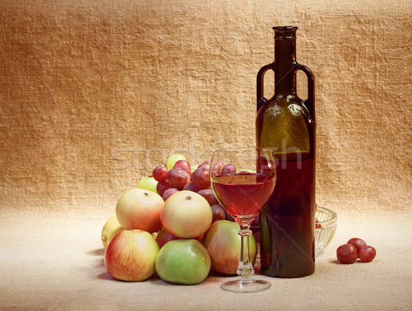 Wine and fruit against brown sacking Stock photo © pzaxe