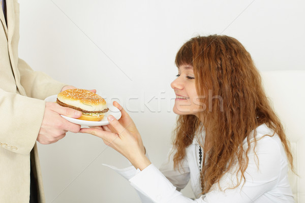 Young beautiful girl rejoices to tasty meal Stock photo © pzaxe