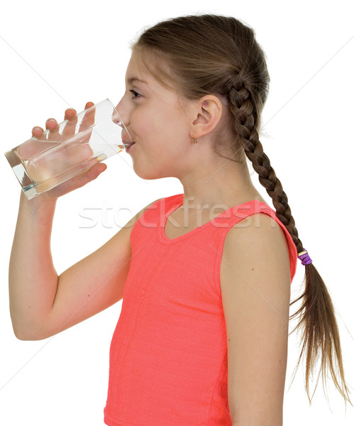 Stock photo: Girl drinks water from a glass