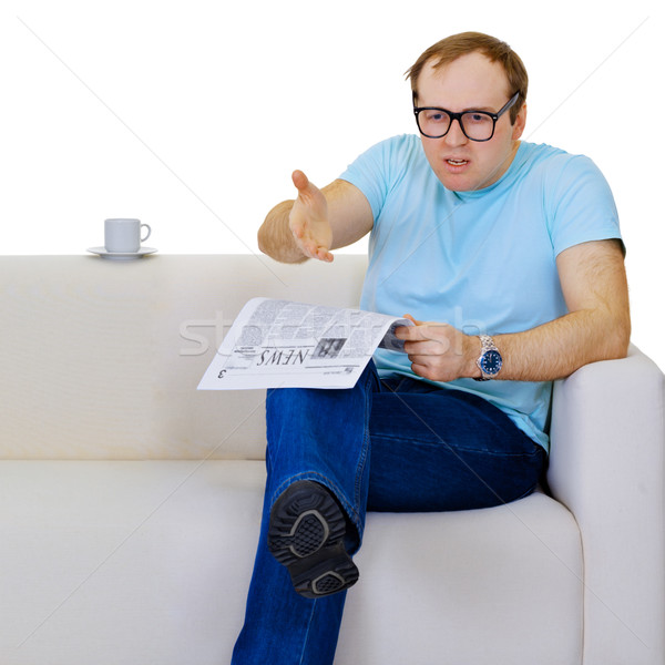 Funny man dissatisfied with news from the newspaper Stock photo © pzaxe