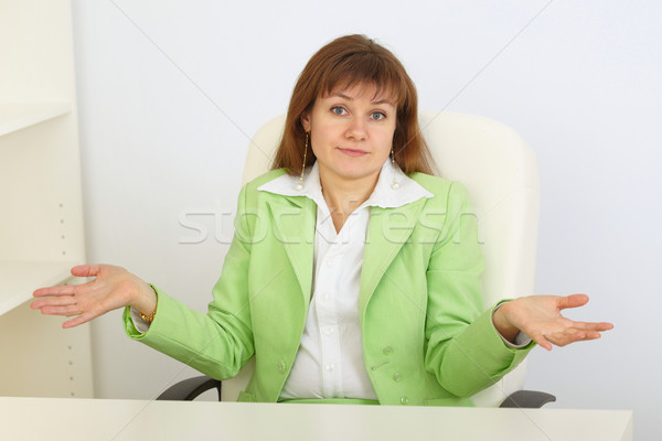 Young business woman with astonishment shrugs shoulders Stock photo © pzaxe