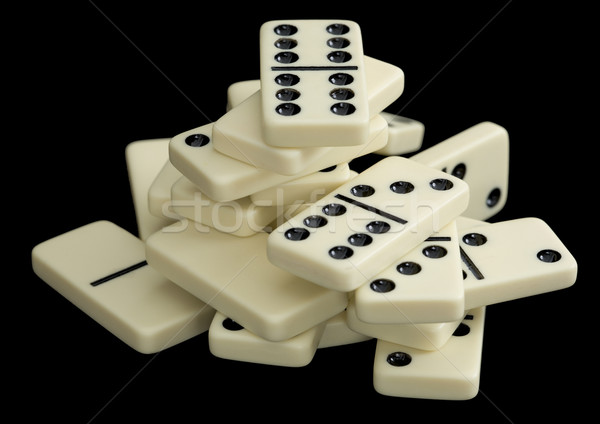 Heap of dominoes on a black background Stock photo © pzaxe