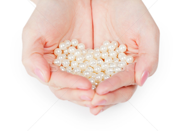 Handful of pearls on white background Stock photo © pzaxe
