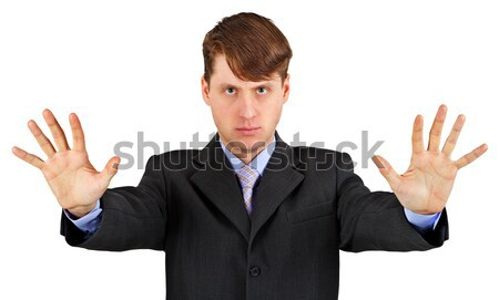 Young businessman extended his arms to show us - stop! Stock photo © pzaxe