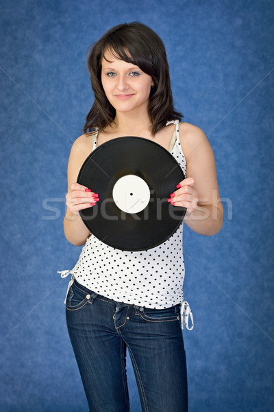 Portrait of the girl with a phonograph record Stock photo © pzaxe