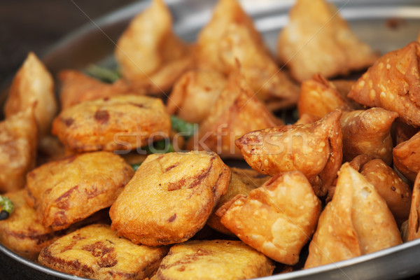 Traditional Indian dish samosa on the open market Stock photo © pzaxe