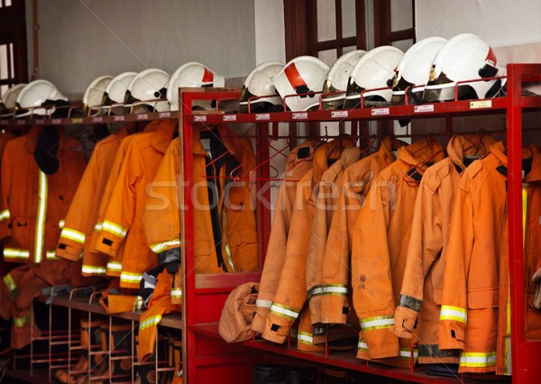 Firefighting Equipment Arranged on Racks at the Fire Station Stock photo © pzaxe