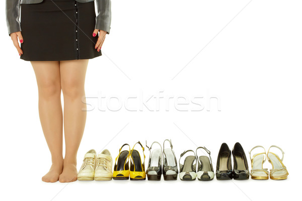 Barefoot woman and lots of shoes Stock photo © pzaxe