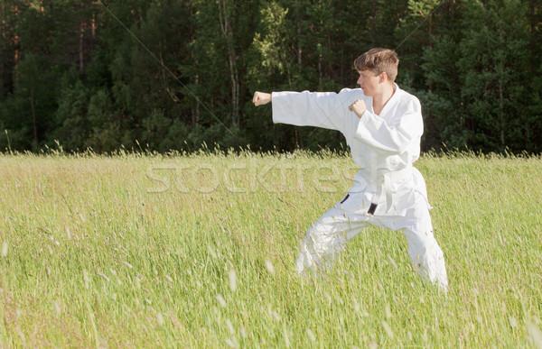 Uomo kimono impegnato combattere sport Foto d'archivio © pzaxe
