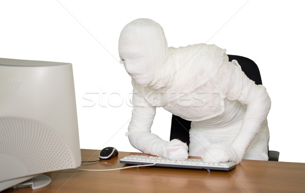 Bandaged businessman on workplace in office Stock photo © pzaxe