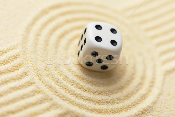 Dice on sand surface - abstract art composition Stock photo © pzaxe