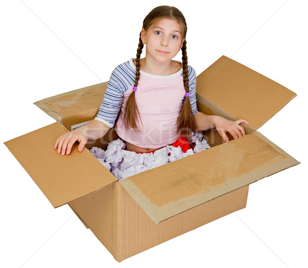 Stock photo: Little girl sits in a cardboard box