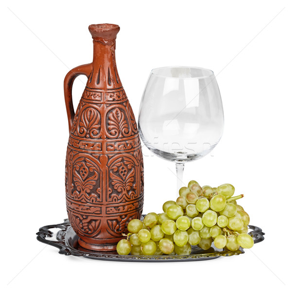 Still life of ceramic bottle, grapes and glass Stock photo © pzaxe