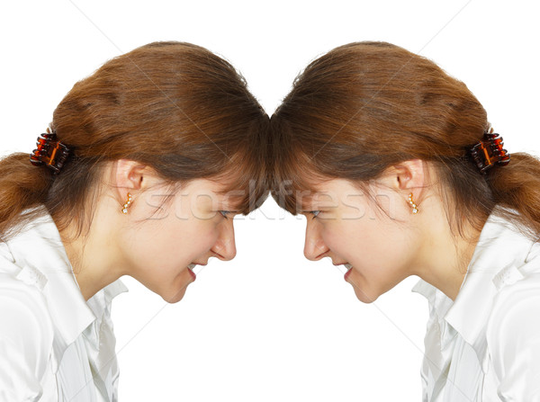 Woman facing her forehead with herself Stock photo © pzaxe