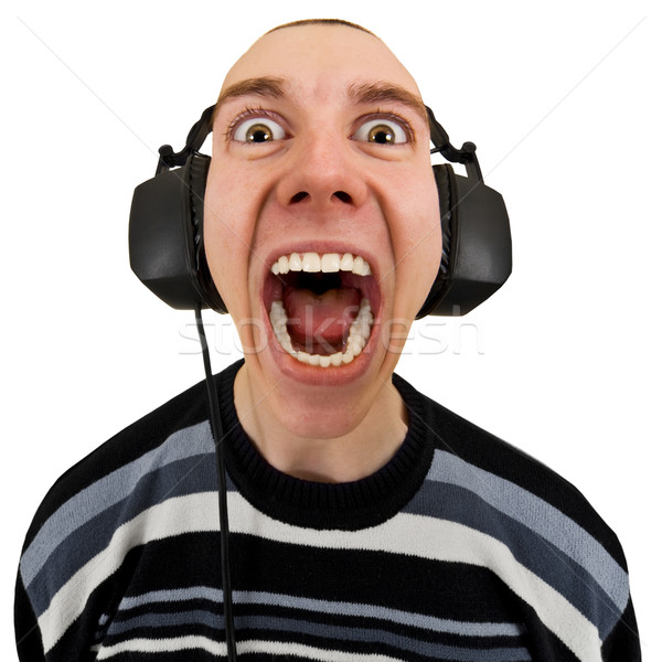 Funny man in stereo headphones shouting Stock photo © pzaxe