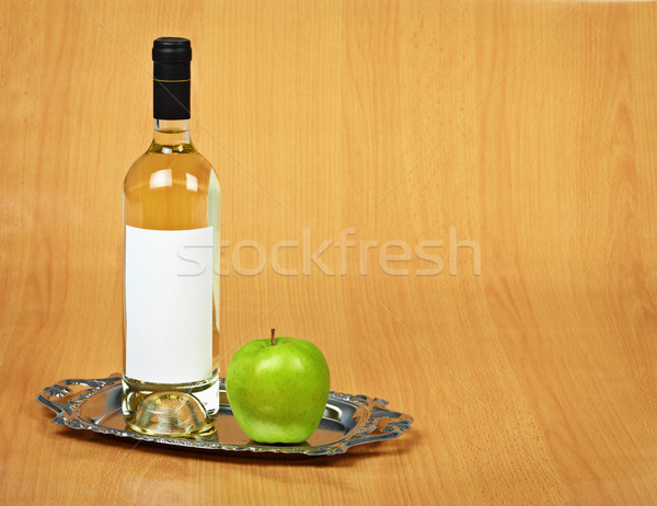 Still-life - bottle of white wine and green apple Stock photo © pzaxe