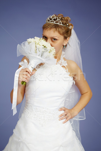 Young Bride smell the flowers Stock photo © pzaxe