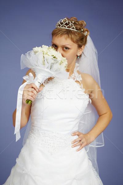 Jóvenes novia olor flores azul ojos Foto stock © pzaxe
