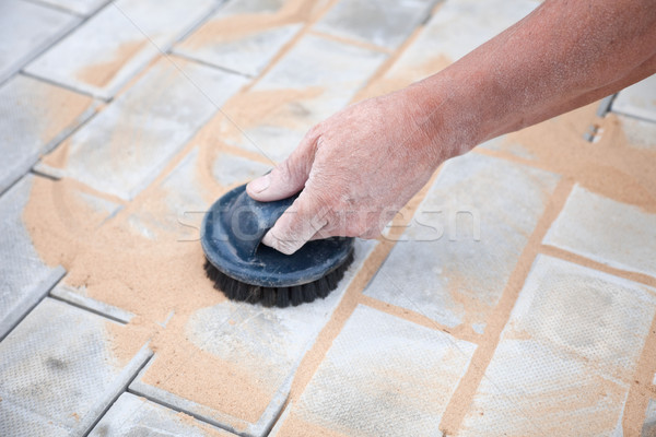 Installation of brick platform - smoothing-out with sand Stock photo © pzaxe