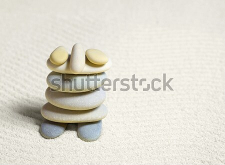 Funny little man made from stones on sand Stock photo © pzaxe