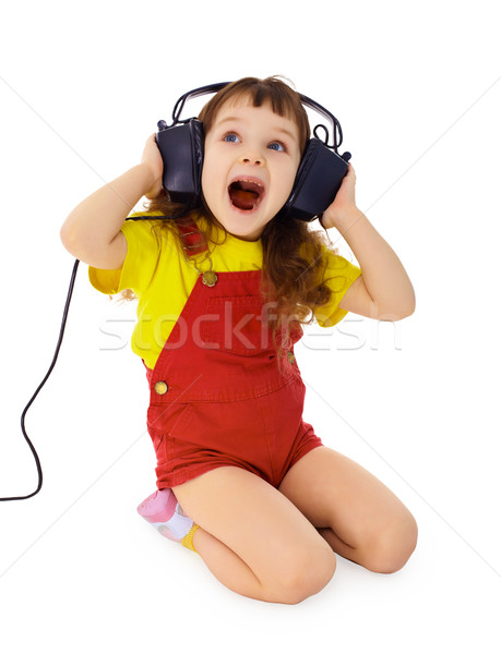 Cheerful little girl sings the music Stock photo © pzaxe