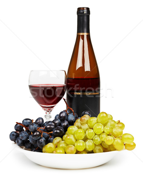 Bottle, glass with red wine and grapes Stock photo © pzaxe