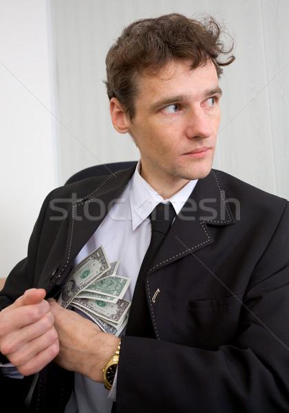 Hombre dinero traje seno mirando alrededor Foto stock © pzaxe
