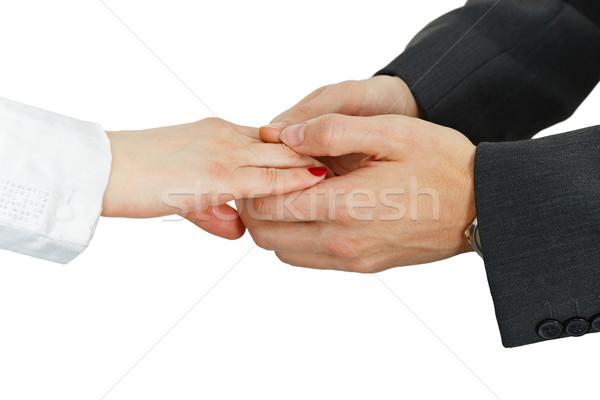 Women's hand in men's hands on white Stock photo © pzaxe