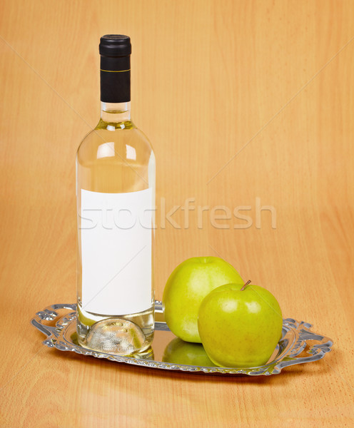 Apple wine in closed bottle on tray Stock photo © pzaxe