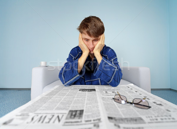 Man with newspaper - hard find a job Stock photo © pzaxe