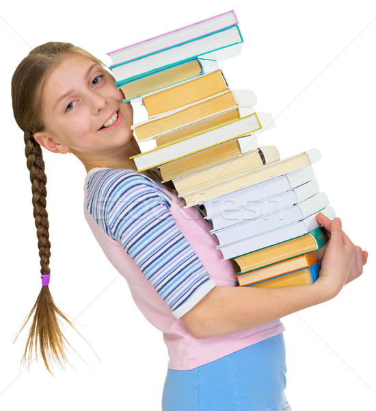 Schoolgirl with the big pile of books in hands Stock photo © pzaxe