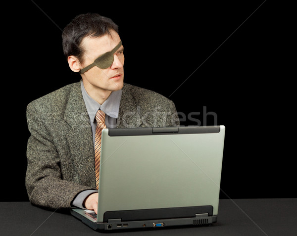 Man - computer pirate with laptop Stock photo © pzaxe