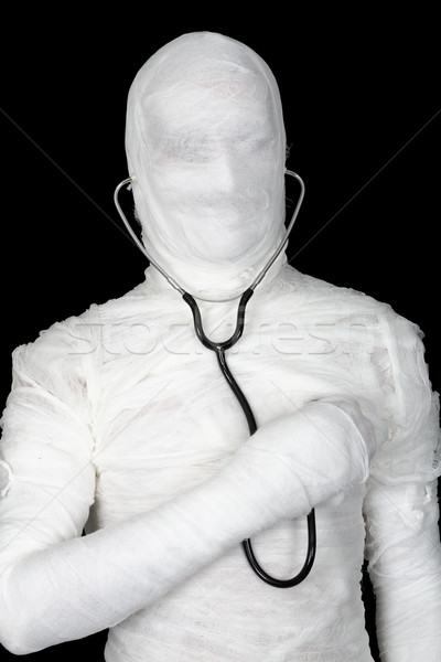 Man in costume mummy with stethoscope Stock photo © pzaxe