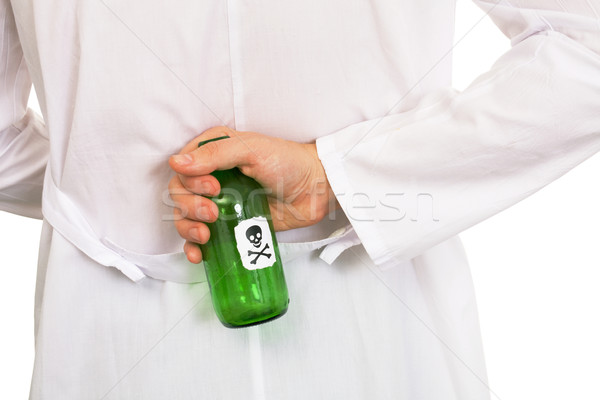 Hand with green bottle Stock photo © pzaxe