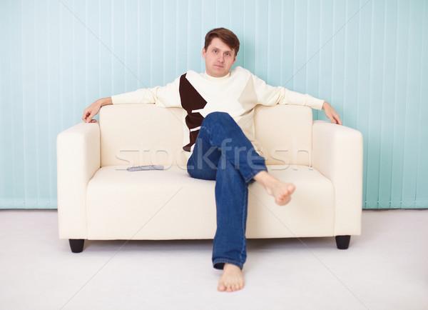 Stock fotó: Fiatalember · puha · kanapé · férfi · otthon · futball