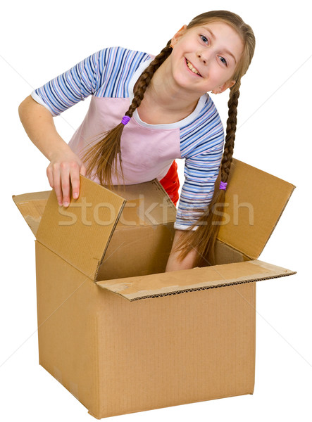 Girl thrust the hand into cardboard box Stock photo © pzaxe