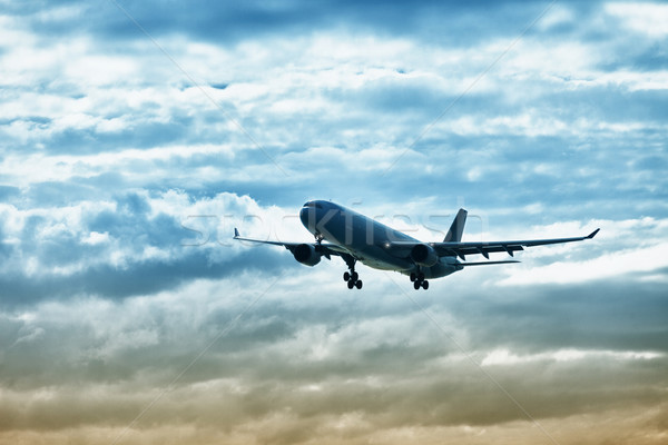 Airliner landing on evening sky Stock photo © pzaxe