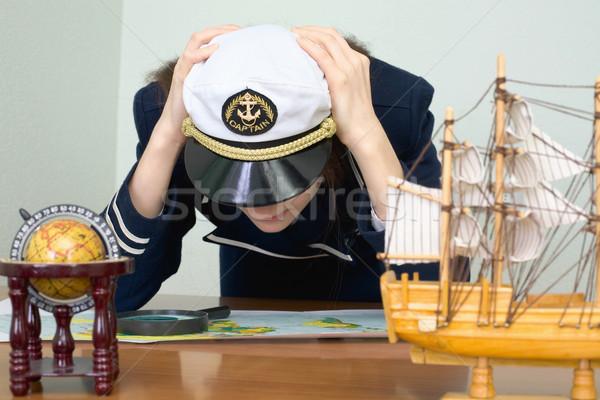 Girl - the sea captain with a card Stock photo © pzaxe