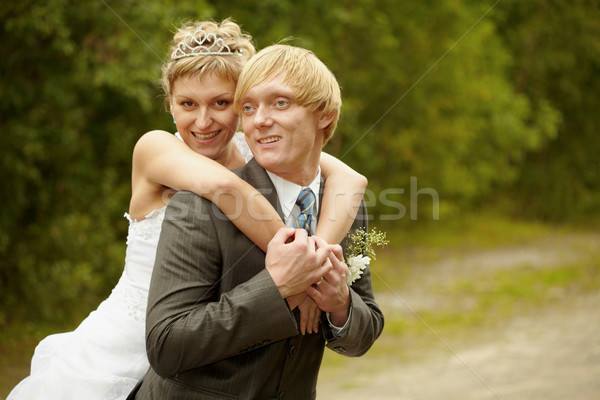 Happy young bride and groom Stock photo © pzaxe