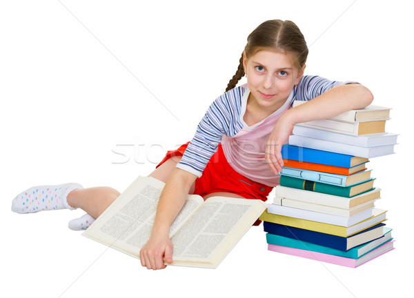 Girl sits having leant the elbows on a books Stock photo © pzaxe