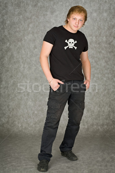 Man in a T-shirt with pirate symbolics Stock photo © pzaxe