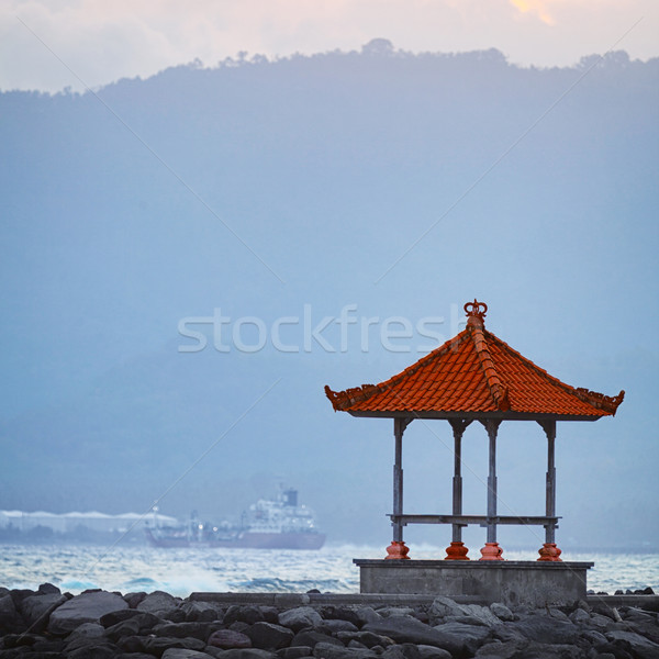 Buddhist Pagoda on a Rocky Jetty Stock photo © pzaxe