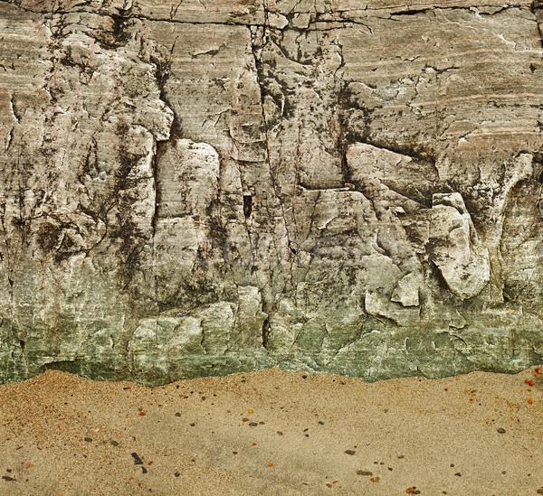 Granite rock on a sandy beach Stock photo © pzaxe