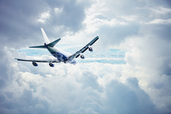 Airliner flying through the thick clouds Stock photo © pzaxe