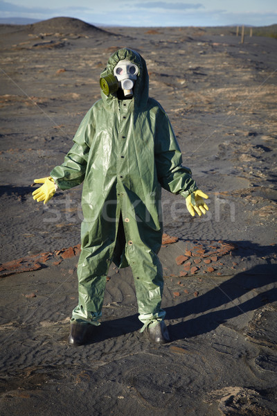 Man in chemical protective suit in desert Stock photo © pzaxe