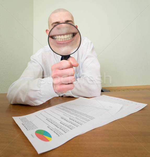 Guy looks through the big magnifier Stock photo © pzaxe