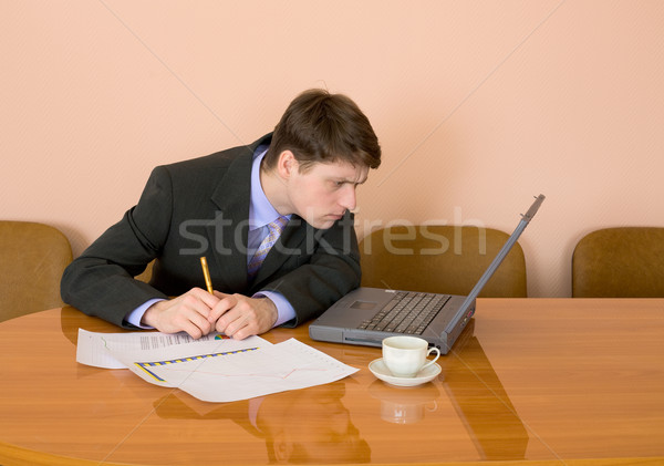 Businessman on a workplace with the laptop Stock photo © pzaxe