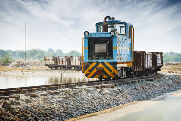 Old small blue locomotive and freight train Stock photo © pzaxe