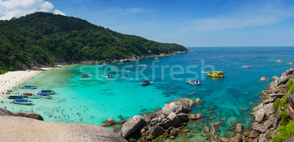 Similan cove beautiful water with people and boats Stock photo © pzaxe